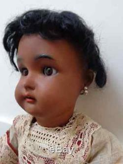 Lovely antique black doll mulatto doll brown bisque original old dress earrings